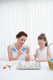 Mother and daughter painting easter eggs Royalty Free Stock Image