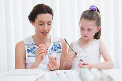Mother and daughter painting easter eggs Royalty Free Stock Photos