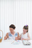 Mother and daughter painting easter eggs Stock Photography