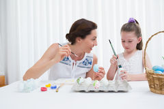 Mother and daughter painting easter eggs Royalty Free Stock Images
