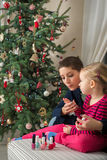 Mother and daughter painting finger nails on xmas day Royalty Free Stock Photo