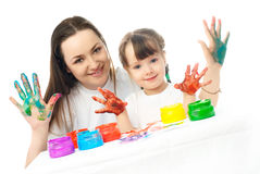 Mother and daughter painting with finger paints Royalty Free Stock Photography