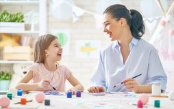 Mother and daughter painting together Royalty Free Stock Image