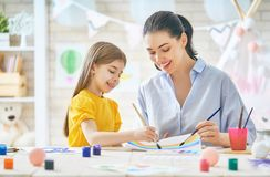 Mother and daughter painting together Royalty Free Stock Photo