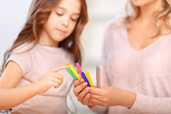 Mother and daughter painting together Stock Photos