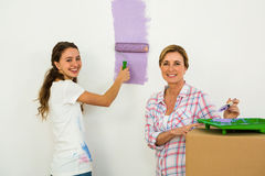 Mother and daughter painting Stock Photos