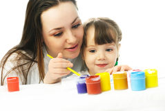 Mother and daughter painting with watercolor Stock Photo