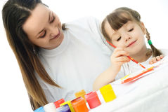 Mother and daughter painting with watercolor Royalty Free Stock Photo