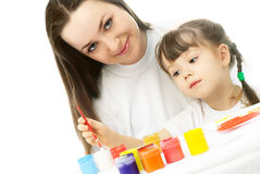 Mother and daughter painting with watercolor Royalty Free Stock Photos