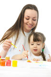 Mother and daughter painting with watercolor Royalty Free Stock Images