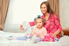 Mother and daughter in pajamas play with a mirror together. Mothers Day Royalty Free Stock Photos