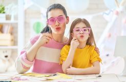 Mother and daughter with paper accessories Stock Image