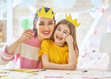 Mother and daughter with paper crowns Stock Image