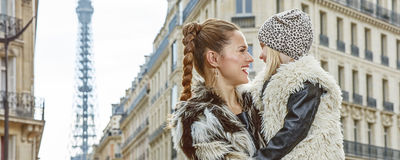 Mother and daughter in Paris, France looking at each other Stock Photo