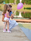 Mother and the daughter in a park. Mother and the  little daughter in a park near a river Stock Photography