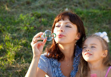 Mother and the daughter in a park. Mother and the  little daughter in a park Royalty Free Stock Photography