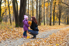 Mother and daughter in a park Stock Photo