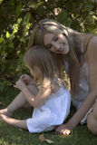 Mother with daughter in the park. Mother hugging daughter in the park on a sunny day Royalty Free Stock Photos