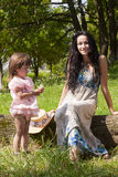 Mother with daughter in the park Stock Photos
