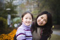 Mother and daughter in park Stock Image