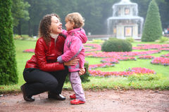 Mother with daughter in park stock photo