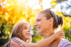 Mother and daughter in the park. Mother and daughter enjoying together in the park Royalty Free Stock Image
