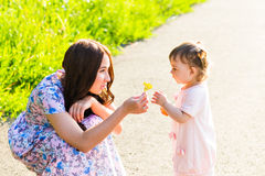 Mother and daughter in the park Stock Images