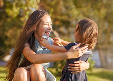 Mother and daughter in park. Mother and daughter having fun in the park Royalty Free Stock Photos