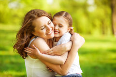 Mother and daughter in park. Mother and daughter hugging in love playing in the park Royalty Free Stock Photos