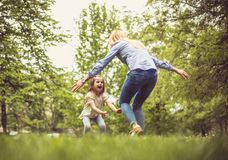 Hug for you. Mother and daughter at park. Little girl running mother in hug stock images