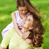 Mother and daughter in park. Mom and daughter having fun in the park. The concept of family values. Mother's Day Royalty Free Stock Images