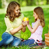 Mother and daughter in park. Mom and daughter having fun in the park. The concept of family values. Mother's Day Royalty Free Stock Photos