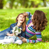 Mother and daughter in park Stock Photos
