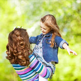 Mother and daughter in park. Mom and daughter having fun in the park. The concept of family values. Mother's Day Stock Images