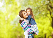 Mother and daughter in park Stock Photo