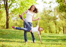 Mother and daughter in park. Mom and daughter having fun in the park. The concept of family values. Mother's Day Royalty Free Stock Photography