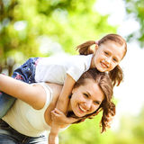 Mother and daughter in park. Mother Day. Stock Photos