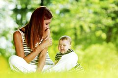 Mother and daughter in park Stock Images