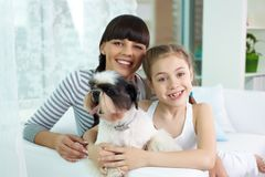 Mother, daughter and pet Royalty Free Stock Images
