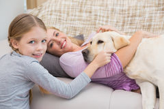 Mother and daughter with pet labrador Royalty Free Stock Photos