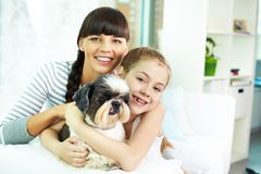 Mother, daughter and pet Stock Photo