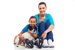 Mother daughter pet Royalty Free Stock Photos