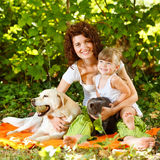 Mother and daughter with pets. Beautiful mother and daughter relaxing in nature with pets Royalty Free Stock Photography