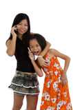 Mother and daughter on the phone Stock Photos