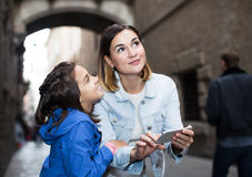 Mother and daughter with phone Stock Photography