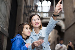 Mother and daughter with phone Royalty Free Stock Photos