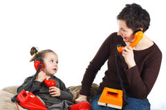 Mother and daughter phoning Royalty Free Stock Images