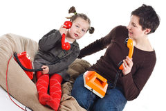 Mother and daughter phoning Royalty Free Stock Photos