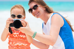 Mother and daughter photographing Royalty Free Stock Photography