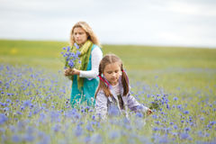 Mother and daughter picking flowers Stock Photo